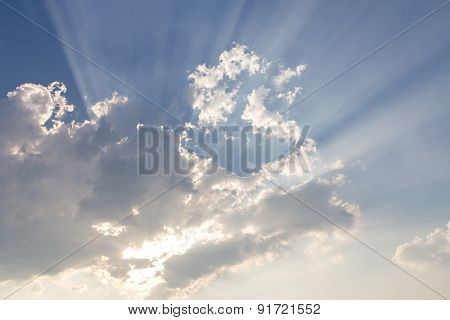 Clouds On Blue Sky And Sun Ray