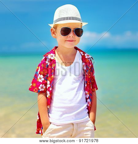 Cute Fashionable Boy Walking On Summer Beach
