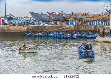 AS-SAWIRA, MOROCCO, APRIL 7, 2015: Blue fishing boats moor in port