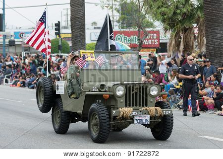 Military Vehicle With Flags During Memorial Day Parade