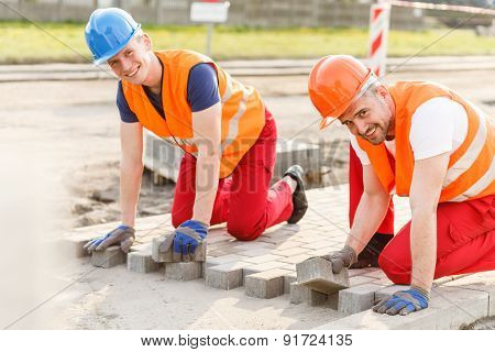 Workers Laying Cobblestones