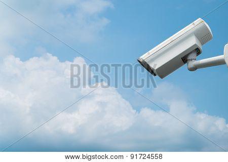 Surveillance Camera On Blue Sky Background