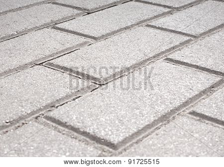 Gray brick stone street road. Light sidewalk, pavement or wall texture