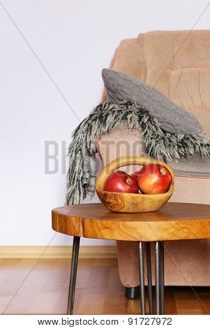 interior elements - chair, blanket, coffee table and red apples
