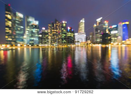 City skyline blur light with water reflection