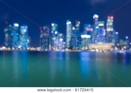 Abstract blurred bokeh city light view with water reflection
