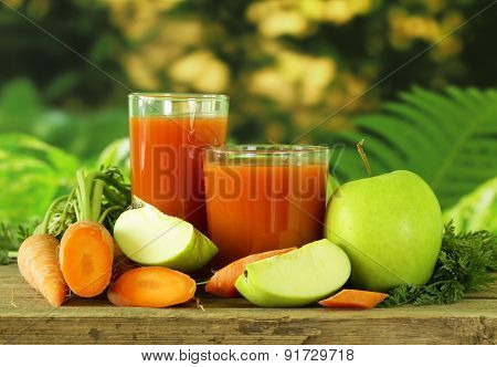natural organic fresh juice of carrots and green apple - healthy eating