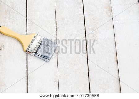 Paint Brush On The White Wooden Table Background