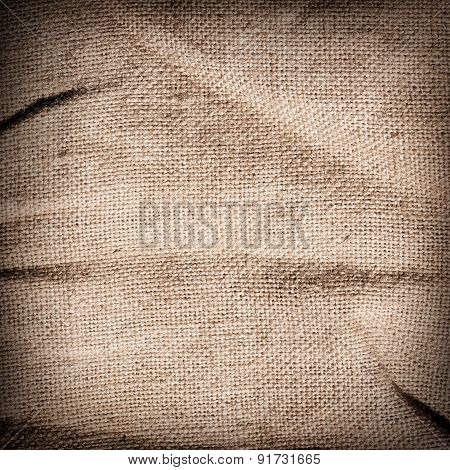 Old dirty brown burlap texture. Square woven fabric