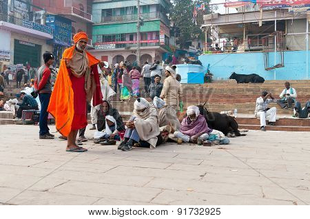 Indian Men On The Ghat Near Sacred River Ganges In Varanasi