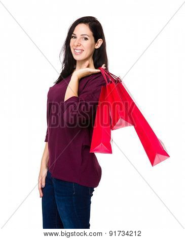 Confident woman holding shopping bag