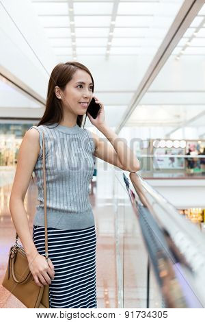 Woman talk to mobile phone at department store