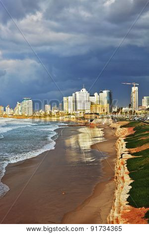 Promenade and beach in Tel Aviv. Storm at sunset in the Mediterranean