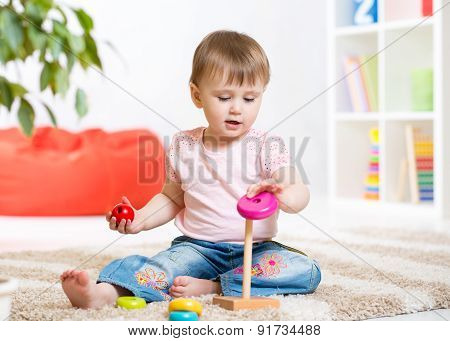 Portrait Of Sweet Little Girl With Toy