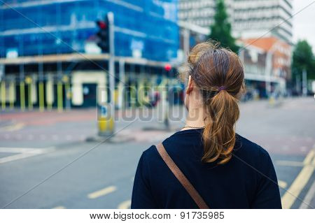 Young Woman Standing In The Street