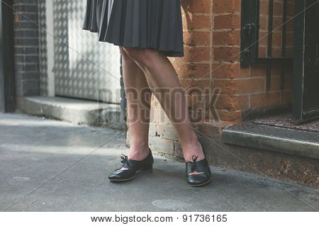 Young Woman In Skirt Standing In The Street