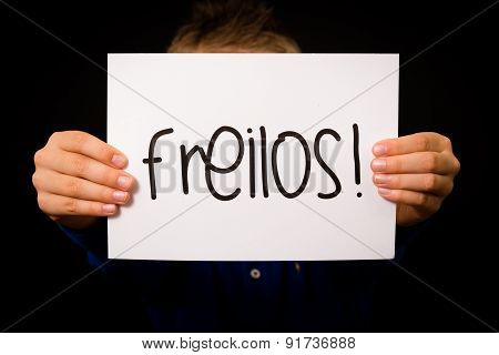 Child Holding Sign With German Word Freilos - See You Later