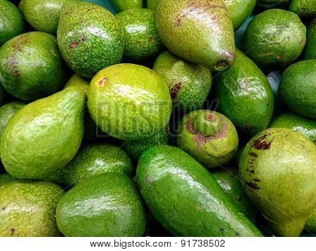 Group of fresh avocados in the supermarket