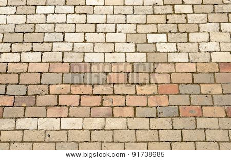 Pavement Bricks Of Beige And Pinkish Colors As Background.