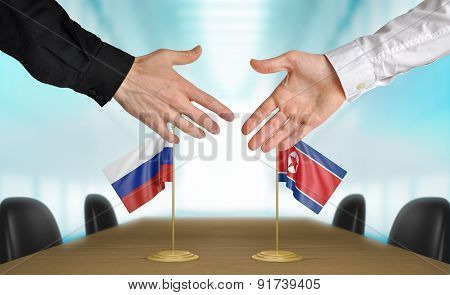 Russia and North Korea diplomats agreeing on a deal