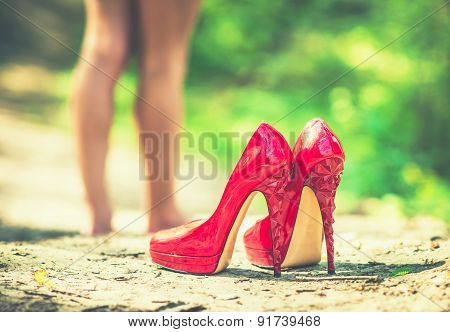 Red High Heels With Barefoot Girl On Background