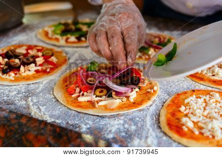 ?The Chef, Who Puts Toppings On A Pizza