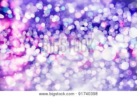 abstract background with bokeh defocused lights and stars