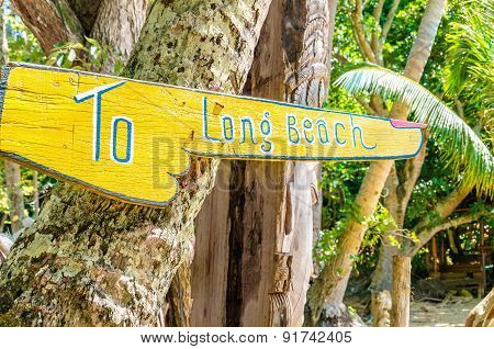 Wooden sign To Long Beach