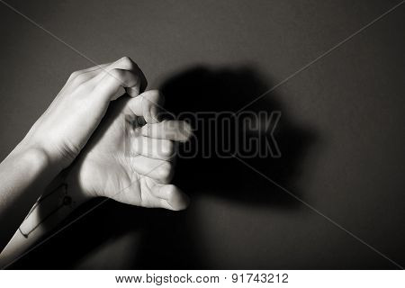 Hands gesture like man face on gray background