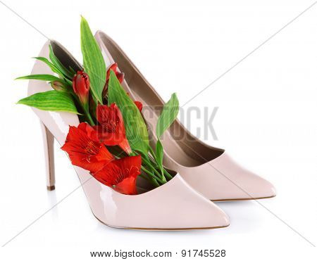 Female shoes with flowers isolated on white