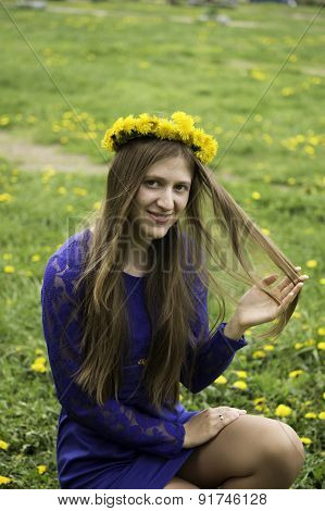 Young Woman In Wreath From Yellow Dandelions. Spring