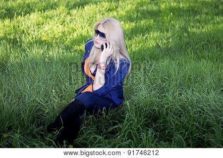 The Girl Tells By Phone On A Lawn