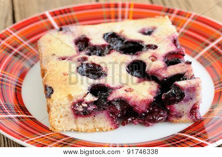 Piece Of Blueberry Pie In Red Checked Plate