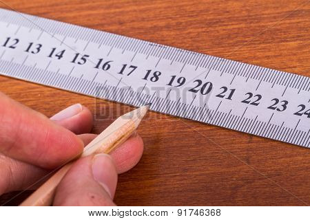 Hand Holding Pencil And Ruler