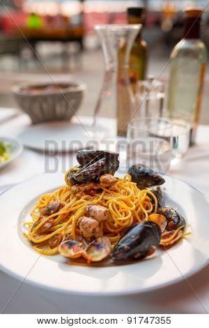 Italian pasta with seafood and herbs