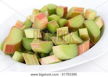 Fresh Rhubarb sliced pieces over white background