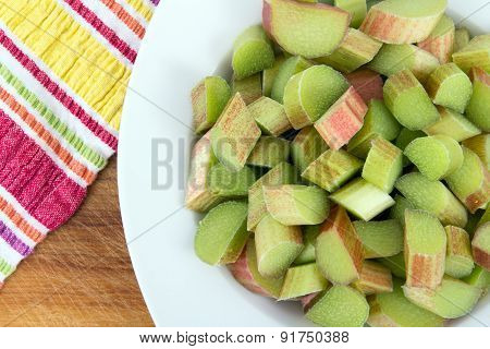 Fresh Rhubarb sliced pieces on table high angle view