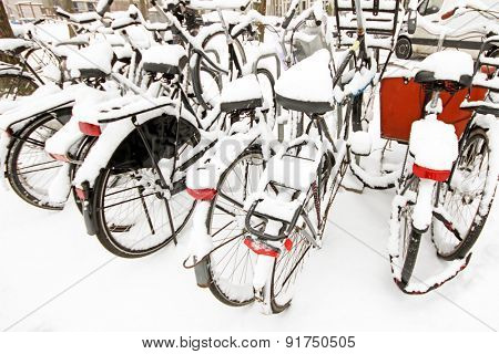 Snowy bikes in Amsterdam in the Netherlands in winter