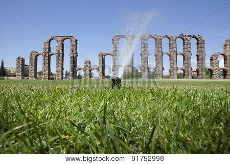 Grass Sprinklers Wtih Roman Aqueduct
