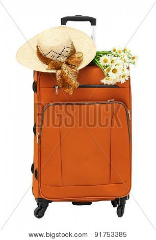 Travel bag with a straw hat and a bouquet of daisies