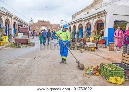 AS-SAWIRA, MOROCCO, APRIL 7, 2015: Local man with broom sweeps the main street  in medina
