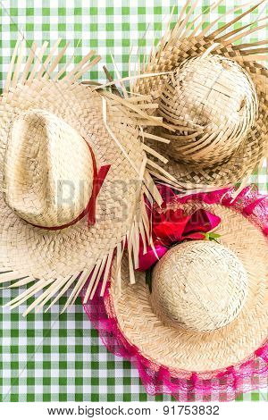 Brazilian traditional Straw Hats on the table (Festa Junina Theme)