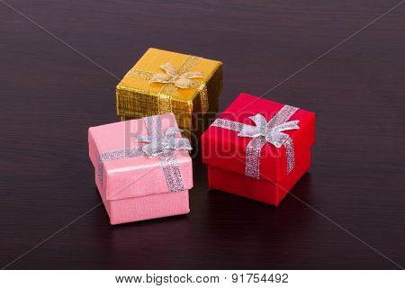 Three Gift Boxes On Wooden