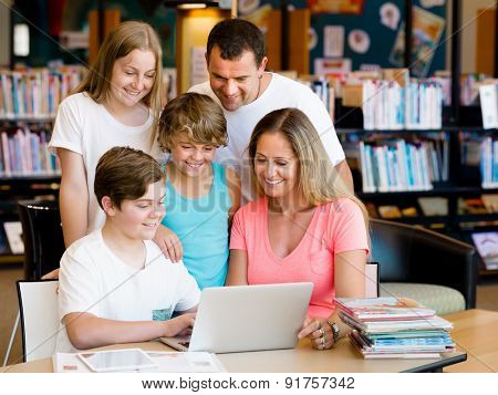Family in library with notebook