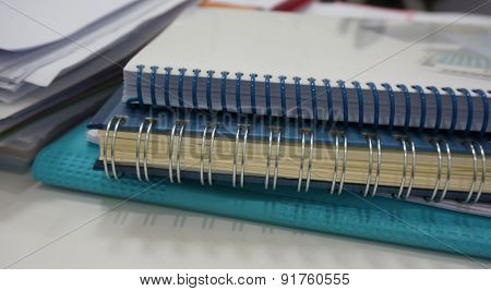 Accounting Book And Pile Of Document