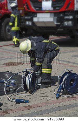 Firefighter Prepare Equipment