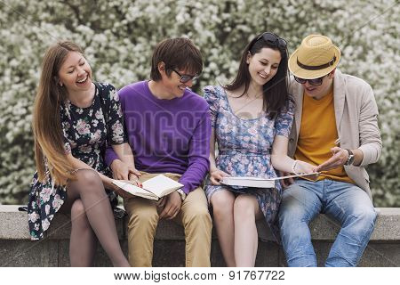 Four Friends In The Park With Books
