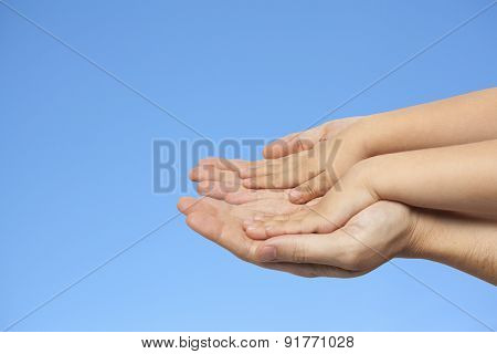Father And Son Holding Hands On Sky Background