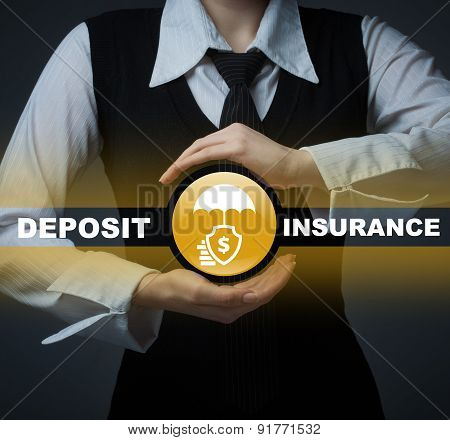 Business Insurance Concept. Man Holding A Symbol Of Deposit Insurance
