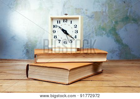 Old Alarm Clock With Books